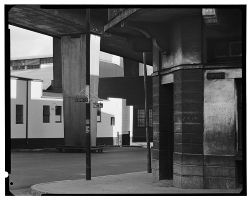 David Goldblatt. On the street corner of Pimm and Goch Streets, under the M1, Newtown, December, 1975.